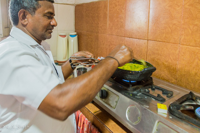 Muthupandi preparing our dinner - gourmet meals from two pots!