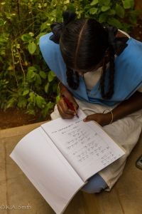 This young lady is writing a 12th standard physics exam and using a fountain pen to boot.